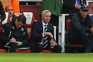 Alan Pardew , Manager of Newcastle United returns to the dug out following a 7 match touchline ban, during the Barclays Premier League match at the Emirates Stadium, London<br /> Picture by David Horn/Focus Images Ltd +44 7545 970036<br /> 28/04/2014