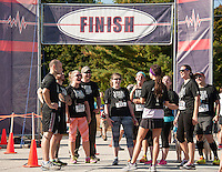 A great team effort was celebrated by the Awakening Chiropractic crew at the finish line for the 5k/10k walk/run event during Saturday's WOW Fest at the Laconia Athletic and Swim Club.  (Karen Bobotas/for the Laconia Daily Sun)