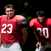 August 31, 2009 - Bronx, NY : The Riverdale Country School football team spent much of the day working out at the school's lower school campus on Monday.  Riverdale senior Ben Darr, left, stretches during practice.