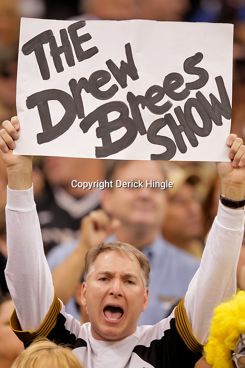 2009 October 18: A New Orleans Saints fan holds up a sign during the first half during a game against the New York Giants at the Louisiana Superdome in New Orleans, Louisiana.