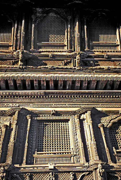 Detail of carved wooden ornament on the exterior of the royal palace, Kathmandu, Durbar Square.
