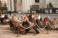 Patrons at a cafe in Central London enjoy the spring weather, London, England.