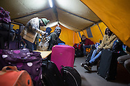 Calais, Pas-de-Calais, France - 25.10.2016    <br />  <br /> Refugees and migrants at the registration shelter. After registration, they are taken by bus to various camps in whole France. 2nd day of the eviction on the so called &rdquo;Jungle&quot; refugee camp on the outskirts of the French city of Calais. Many thousands of migrants and refugees are waiting in some cases for years in the port city in the hope of being able to cross the English Channel to Britain. French authorities announced a week ago that they will evict the camp where currently up to up to 10,000 people live.<br /> <br /> Fluechtlinge und Migranten in der Registrierungszone. Nach der Registrierung werden sie mit Bussen auf Camps in ganz Frankreich aufgeteilt. Zweiter Tag der Raeumung des so genannte &rdquo;Jungle&rdquo;-Fluechtlingscamp in der franz&ouml;sischen Hafenstadt Calais. Viele tausend Migranten und Fluechtlinge harren teilweise seit Jahren in der Hafenstadt aus in der Hoffnung den Aermelkanal nach Gro&szlig;britannien ueberqueren zu koennen. Die franzoesischen Behoerden kuendigten vor einigen Wochen an, dass sie das Camp, indem derzeit bis zu bis zu 10.000 Menschen leben raeumen werden. <br /> <br /> Photo: Bjoern Kietzmann