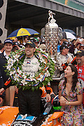 Dario Franchitti celebrates in Victory Circle with his wife Ashley Judd after winning the Indy 500 race on May 27, 2007 in Speedway, Indiana. Photo by Michael Hickey