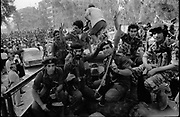 Beirut, Lebanon September 1982. Palestinian fighters departure. Palestinian fighters waving goodby while sitting in a truck wich will take them to the port to embark for the new destinations of their exile, at the end of the 1982 Israeli siege. ©Herve Merliac