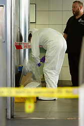 © Licensed to London News Pictures. 02/09/2019. London, UK. A forensics officer works inside Elephant and Castle station after two men were found seriously injured following a stabbing last night. A murder investigation has been launched following the death of one of the victims.Photo credit: George Cracknell Wright/LNP