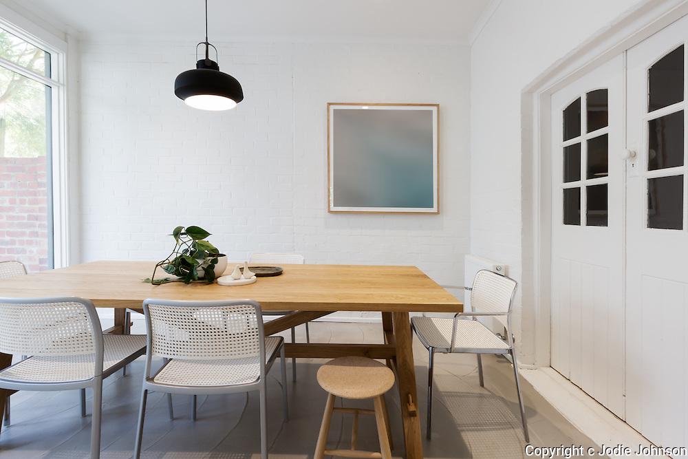 Modern scandinavian styled interior dining room with pendant light in Australia horizontal