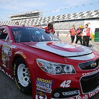 Crew members of the Kyle Larson Target Chevrolet push the car to the inspection area prior to the 56th Annual NASCAR Daytona 500 race at Daytona International Speedway on Sunday, February 23, 2014 in Daytona Beach, Florida.  (AP Photo/Alex Menendez)