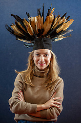 Pictured: Alexandria Kasplzyhsha models a 20th centuray Bamikele Feather Dance Hat from the Cameroon<br /> <br /> A coconut collecting box valued at GBP500-GBP700, once in the possession of Scottish missionary John Paton, is among the highlights of the African & Oceanic sale which takes place on 1 May.<br /> <br /> Ger Harley | EEm 29 April 2019