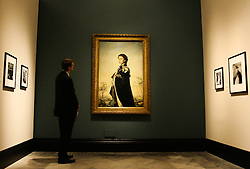 © Licensed to London News Pictures. 16/05/2012. London,Britain.A visitor of the gallery National Portrait Gallery is looking at the portrait  of Queen Elizabeth II by Pietro Annigoni.The exhibition includes formal painted portraits, official photographs, press images and works by contemporary artists exploring the evolution of the Queen's image throughout the 60 years of her reign.Photo credit : Thomas Campean/LNP