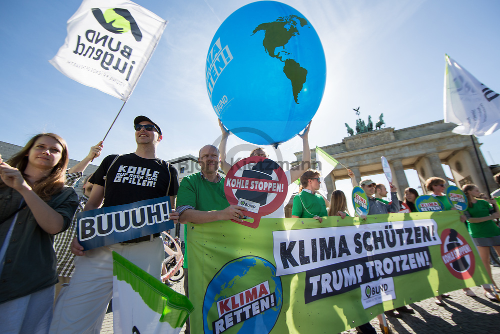 Berlin, Germany - 01.06.2017<br /> <br /> Climate protection protest by the Friends of Earth Germany near the US Embassy and the Brandenburg Gate against a possible withdrawal of the US-President Donald Trump from the international climate protection agreement.<br /> <br /> Klimaschutz Protest des Bund fuer Umwelt und Naturschutz Deutschland vor der US-Botschaft nahe des Brandenburger Tor gegen einen moeglichen Ausstiegs von US-Praesident Donald Trump aus dem internationalen Klimaschutz-Abkommen.<br /> <br /> Photo: Bjoern Kietzmann