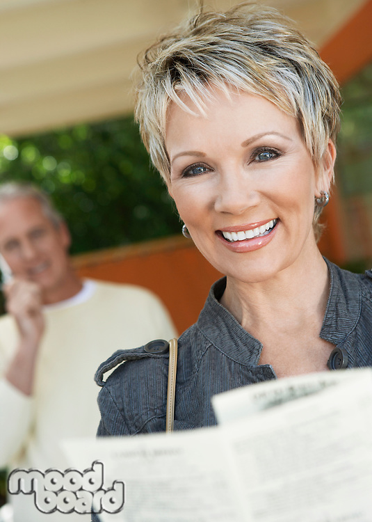 Smiling Woman Reading a Brochure