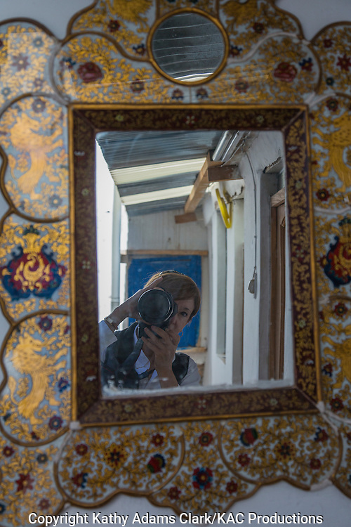 Kathy Adams Clark; reflecting in a mirror, Cusco, Peru;