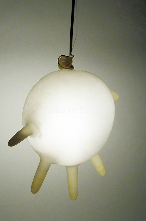 inflated rubber glove as hanging light