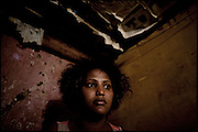 "Sennait, 21 years old, waits customers in her shack. She works in a red light district of Addis Ababa. Sold in marriage at the age of 8 years to a man, manages to escape from him who abused her. The girls who are forced to marry face a number of problems, and often suffer health problems as a result of having sexual relations from an early age. These girls are being violated physically and emotionally. Child marriage was a major issue raised by the 2007 United Nations Commission on the Status of Women. A U.S. resolution to reduce the practice was passed, encouraging countries to take actions. In Ethiopia the legal age to get married is 18, the law quite often is ignored. Addis Ababa, Ethiopia, on thursday, Febrary 19 2009.....In a tangled mingling of tradition and culture, in the normal place of living, in a laid-back attitude. The background of Ethiopia's ""child brides"", a country which has the distinction of having highest percentage in the practice of early marriages despite having a law that establishes 18 years as minimum age to get married. Celebrations that last days, their minds clouded by girls cups of tella and the unknown for the future. White bridal veil frame their faces expressive of small defenseless creatures, who at the age ranging from three to twelve years shall be given to young brides men adults already...To protect the identities of the recorded subjects names and specific places are fictional."