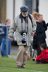 FLINT, WALES - Thursday, May 12, 2011: Daily Post Wales photographer Les Williams during the Men's Under-17's International Friendly match at Cae-y-Castell. (Photo by David Rawcliffe/Propaganda)