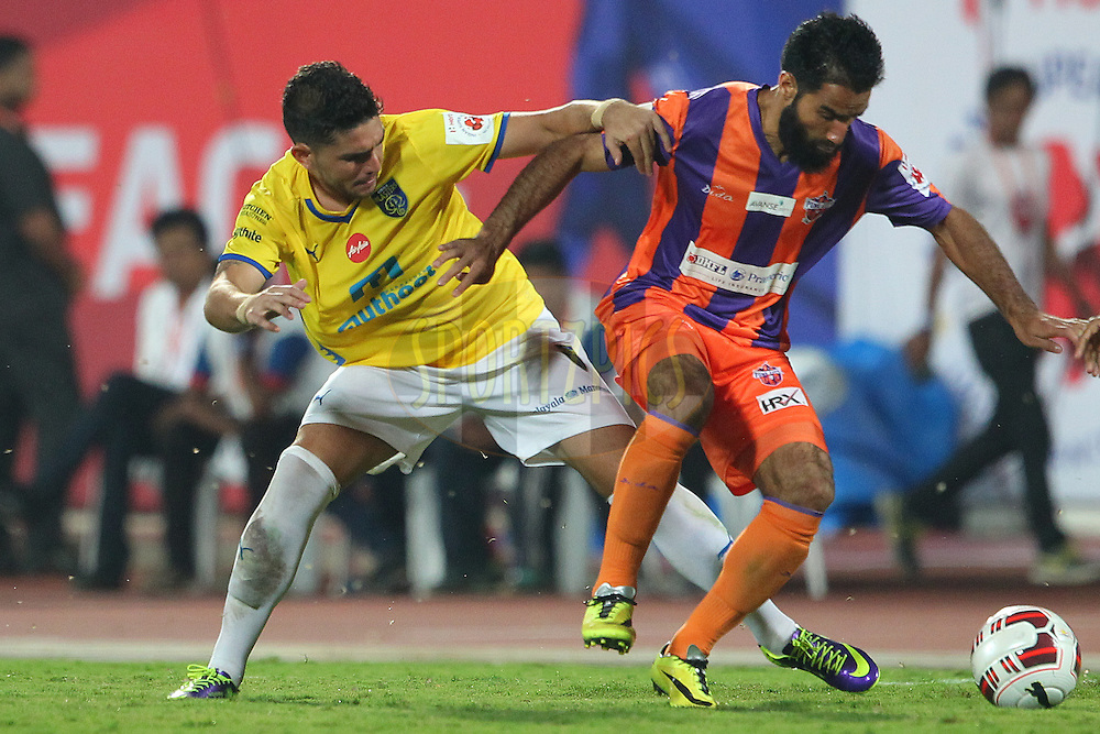 Pedro Adriano Veloso Gusmao of Kerala Blasters FC battles with Mehrajuddin Wadoo of FC Pune City during match 17 of the Hero Indian Super League between FC Pune City<br /> and Kerala Blasters FC held at the Shree Shiv Chhatrapati Sports Complex Stadium, Pune, India on the 30th October 2014.<br /> <br /> Photo by:  Ron Gaunt/ ISL/ SPORTZPICS