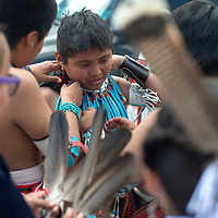 Keelan Nastacio from the Kallestewa dance group gets help adjusting his necklace between dance sets Saturday at the Zuni Main Street Festival in Zuni.