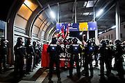 Frankfurt | 07 October 2016<br /> <br /> Am Freitag (07.10.2016) versammelten sich in Wetzlar etwa 80 Neonazis aus dem Umfeld der NPD, von neonazistischen Freien Kameradschaften, dem sog. Freien Netz Hessen und der Identit&auml;ren Bewegung zu einer Demonstration &quot;gegen &Uuml;berfremdung&quot;. Die geplante Demo-Route war von etwa 1600 Anti-Nazi-Aktivisten blockiert, daher wurde den Neonazis eine neue Demoroute durch Altstadt und Innenstadt von Wetzlar vorbei am Wetzlarer Dom zugewiesen. Auch hier stellten sich den Rechten immer wieder Aktivisten in den Weg.<br /> Hier: Auf ihrem Weg vom Treffpunkt auf einem Parkplatz am Bahnhof von Wetzlar zu ihrer Ersatzroute in die Innenstadt werden die Neonazi-Aktivisten von der Polizei aufgehalten.<br /> <br /> photo &copy; peter-juelich.com<br /> <br /> FOTO HONORARPFLICHTIG, Sonderhonorar, bitte anfragen!