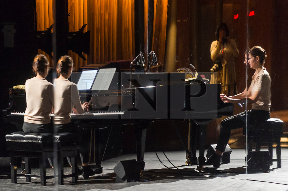 "© Licensed to London News Pictures. 24/10/2019. LONDON, UK. The pianist at a rehearsal of the UK premiere of ""For Four Walls"", choreographed by Petter Jacobsson and Thomas Caley, performed by CCN-Ballet de Lorraine to a solo piano score, at the Royal Opera House in Covent Garden.  The choreography takes place inside a mirrored space and is a re-imagined piece based on a once-lost 1944 work called ""Four Walls"".  The show is part of this years Dance Umbrella Festival which runs to 27 October.   Photo credit: Stephen Chung/LNP"