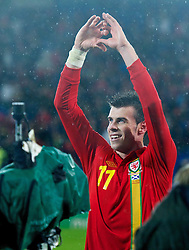 12.10.2012, Cardiff City Stadium, Cardiff, WAL, FIFA WM Qualifikation, Wales vs Schottland, im Bild Wales' two-goal hero Gareth Bale celebrates beating Scotland 2-1 during during FIFA World Cup Qualifier Match between Wales and Scotland at the Cardiff City Stadium, Cardiff, Wales on 2012/10/12. EXPA Pictures © 2012, PhotoCredit: EXPA/ Propagandaphoto/ David Rawcliffe..***** ATTENTION - OUT OF ENG, GBR, UK *****