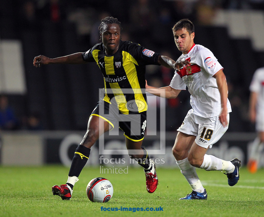 Picture by James Ward/Focus Images Ltd.  07908 205049.30/8/11.Marcus Bean of Brentford gets away from George Baldock of MK Dons during the Johnstone's Paint Trophy Round 1 match at stadium MK in Milton Keynes, Buckinghamshire.