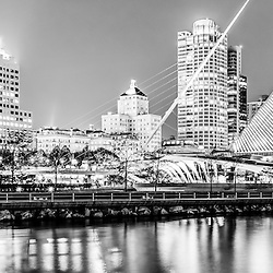 Panorama photo of Milwaukee skyline at night in black and white. Photo includes the Milwaukee lakefront, Milwaukee Art Museum, University Club Tower, and Northwestern Mutual Tower. Panorama photo ratio is 1:3 and image is high resolution.