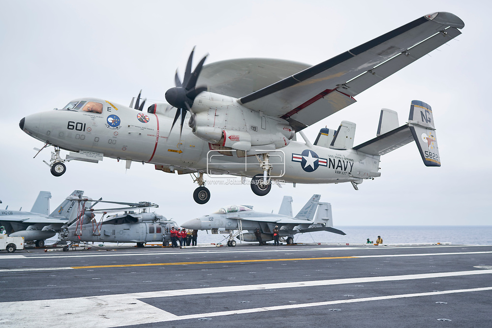 October 29, 2017. San Diego, California. Daily life on board the US Navy's Nimitz-class aircraft carrier, the USS Carl Vinson. The 1092 ft long, 95,000 ton vessel was training in the Pacific Ocean. Pictured is an E-2 Hawkeye.<br /> Photo copyright John Chapple / www.JohnChapple.com