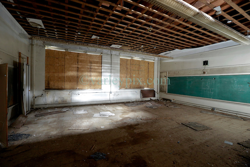 19 May 2015. New Orleans, Louisiana.<br /> The derelict Alfred C Priestley Junior High School.<br /> The old school in Pigeon Town has fallen into serious disrepair since 1980 when the last students and teachers left the building. The school was then used as office space and later as a warehouse until 1993. Hurricane Katrina only accelerated the decline. French charter school Lyc&eacute;e Francais recently purchased the crumbling wreck for $425,000 and have grand plans to return a middle and high school to the neighborhood. <br /> Photo; Charlie Varley/varleypix.com