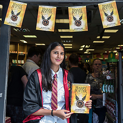 "© Licensed to London News Pictures. 31/07/2016. London, UK.  A store member, dressed in costume, greets fans of the Harry Potter books series visiting Waterstones bookshop in Harrow to buy the ""Harry Potter and the Cursed Child"", the script, in book form, of the play by JK Rowling. Photo credit : Stephen Chung/LNP"