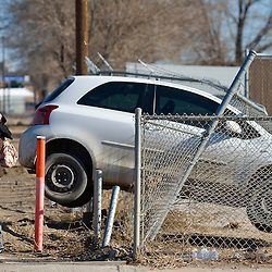 121511       Brian Leddy.Derrick Romero hugs Dempsi Chapito after she wrecked her mothers car on North Ninth Street Friday. According to the police report, Chaptio was traveling south on the road when she tried to make a left hand turn into the Juggernaut, but was driving too fast and crashed her car into the fence. No injuries were reported and no citations were issued. .