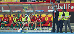 06.09.2013, Philip II Arena, Skopje, MKD, FIFA WM Qualifikation, Mazedonien vs Wales, Rueckspiel, im Bild A security guard stands watch as Wales' Gareth Bale sits on the substitutes' bench in action against Macedonia during the FIFA World Cup Qualifier second leg Match between Macedonia and Wales at the Philip II Arena in Skopje, Macedonia on 2013/09/06. EXPA Pictures © 2013, PhotoCredit: EXPA/ Propagandaphoto/ David Rawcliffe<br /> <br /> ***** ATTENTION - OUT OF ENG, GBR, UK *****
