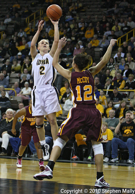 February 18, 2010: Iowa guard Kamille Wahlin (2) shoots over Minnesota guard Brittany McCoy (12) during the first half of the NCAA women's basketball game at Carver-Hawkeye Arena in Iowa City, Iowa on February 18, 2010. Iowa defeated Minnesota 75-54.