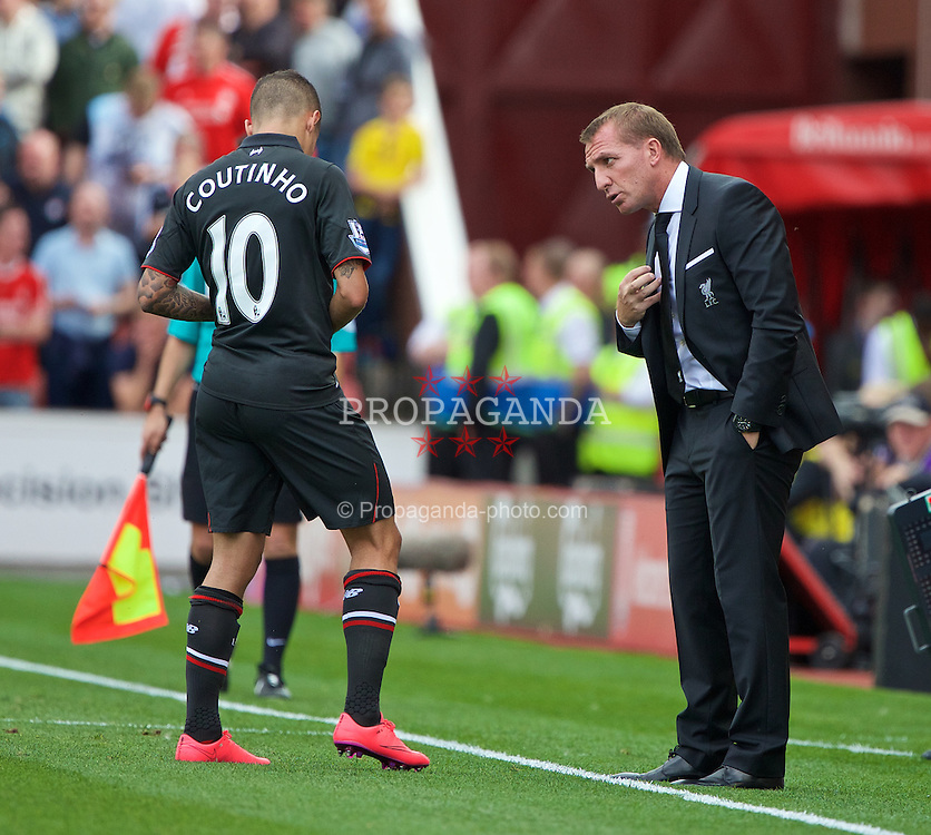 STOKE-ON-TRENT, ENGLAND - Sunday, August 9, 2015: Liverpool's manager Brendan Rodgers gives instructions to eventual match-winning goal-scorer Philippe Coutinho Correia during the Premier League match against Stoke City at the Britannia Stadium. (Pic by David Rawcliffe/Propaganda)