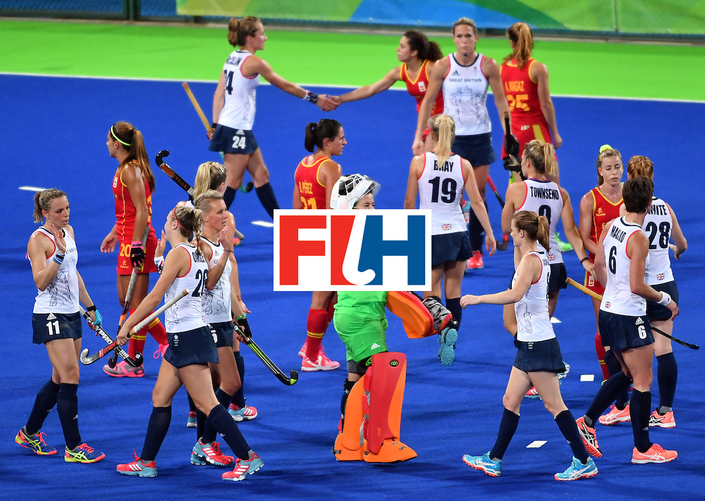 Britain and Spain's players greet each other after the women's quarterfinal field hockey Britain vs Spain match of the Rio 2016 Olympics Games at the Olympic Hockey Centre in Rio de Janeiro on August 15, 2016. / AFP / Pascal GUYOT        (Photo credit should read PASCAL GUYOT/AFP/Getty Images)
