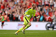 Adam Davies of Barnsley celebrates the goal of Lloyd Isgrove of Barnsley (not pictured) to make the scoreline 3-1 during the Sky Bet League 1 Play-off Final between Barnsley and Millwall at Wembley Stadium, London<br /> Picture by Richard Blaxall/Focus Images Ltd +44 7853 364624<br /> 29/05/2016