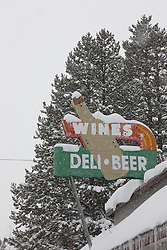 """""""Snowy Wine Sign in Truckee"""" - This snow covered old Wines Deli and Beer sign was photographed in the early morning in Truckee, California."""