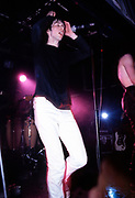 Bobby Gillespie of Primal Scream on stage at the Hacienda, Manchester 1991