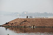 This empty strip of land on the edge of Lake Victoria will be bustling in a few short hours, once the fishermen come in for the day to sell their catches. Here in Ggaba, a small town in southern Uganda that almost entirely subsists on the fishing industry, the locals have contributed to the dangerous overfishing of the lake despite strict regulations from Tanzania, Uganda, and Kenya. Fishermen continue to keep fish that are far below the required minimum weight and employ dymanite and poison.