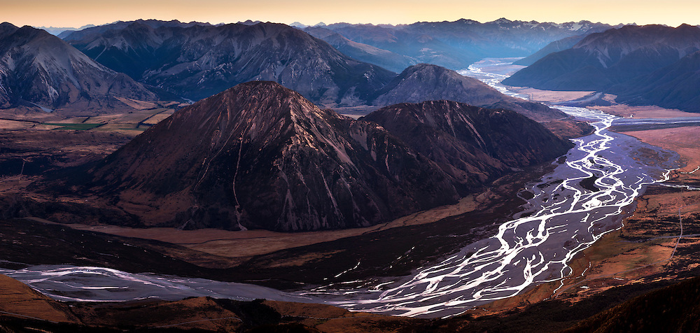 Wide view of the braided river Waimakariri at dusk, looking west from Mt Binser. Canterbury, New Zealand