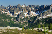 View of rugged overlapping peaks and ridges of the North Cascades. From Cutthoat Pass looking towards Liberty Bell Mountain.