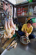 Phnom Penh, Cambodia. Central Market. Chicken butcher.