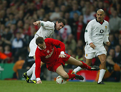 CARDIFF, WALES - Sunday, March 2, 2003: Liverpool's Dietmar Hamann is tackled by Manchester United's Roy Keane during the Football League Cup Final at the Millennium Stadium. (Pic by David Rawcliffe/Propaganda)