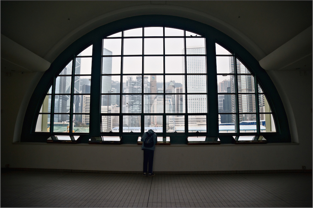Large, arched window in Central ferry pier, Hong Kong, looking toward Central district