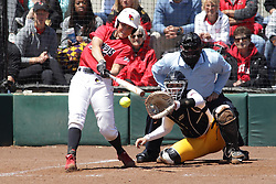 26 April 2015:   Batting for the Redbirds is Payton Billups catching for the Ramblers is Annie Korth during an NCAA Missouri Valley Conference (MVC) Championship series women's softball game between the Loyola Ramblers and the Illinois State Redbirds on Marian Kneer Field in Normal IL