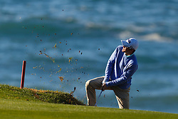 Feb 8, 2012; Pebble Beach CA, USA;  Scott Langley hits out of a bunker on the fourth hole during the practice round of the AT&T Pebble Beach Pro-Am at Pebble Beach Golf Links. Mandatory Credit: Jason O. Watson-US PRESSWIRE