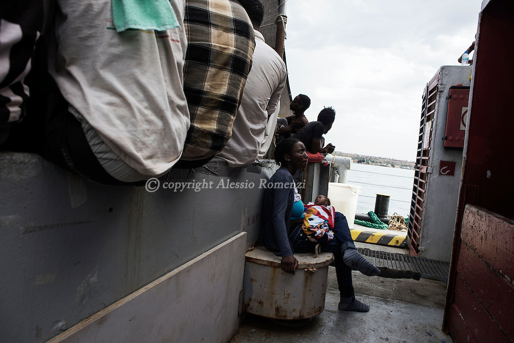 Italy: MSF Dignity1: Migrants rescued at sea are seen as the Dignity1enter the port of Augusta on August 25, 2015. Alessio Romenzi