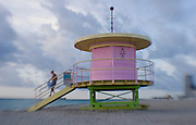 colorful lifeguard stand  greets a new day in the tropical early morning light on Miami South Beach