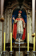 A likeness of St. Bonaventure is featured above the altar in San Buenaventura Mission in Ventura, Calif. The 18th-century Mexican Spanish Colonial statue was recently restored in a process that removed overpaint to reveal the statue's original colors and detail. © 2015 Nancy Wiechec