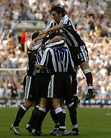 Photo. Glyn Thomas.<br /> Newcastle United v Chelsea. <br /> FA Barclaycard Premiership. 25/04/2004.<br /> Newcastle's Alan Shearer is mobbed by Hugo Viana (R) and other teammates after his brilliant second half goal.